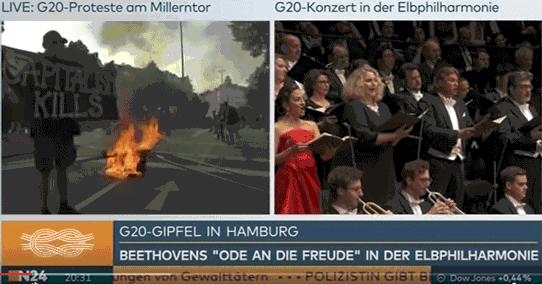 parallele live-Bilder des abgeschotteten G20-Gipfel-Teilnehmer-Konzerts und dem Straßenkampf am 8.7.2017 von n24 'Alle Menschen werden Brüder'